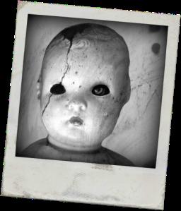 PHOTOGRAPH: Street art depicting a broken doll's head.